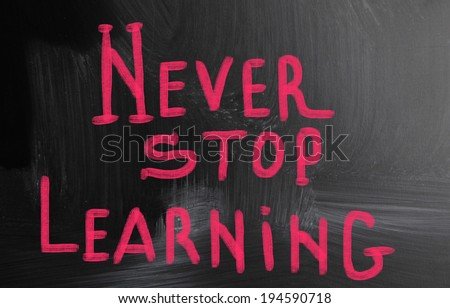 never stop learning handwritten with chalk on a blackboard - stock photo