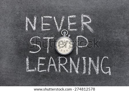 never stop learning phrase handwritten on chalkboard with vintage precise stopwatch used instead of O - stock photo