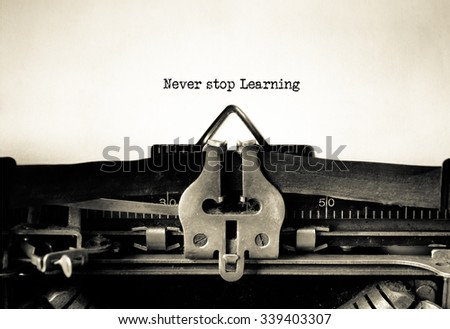 Never Stop Learning word typed on a Vintage Typewriter.