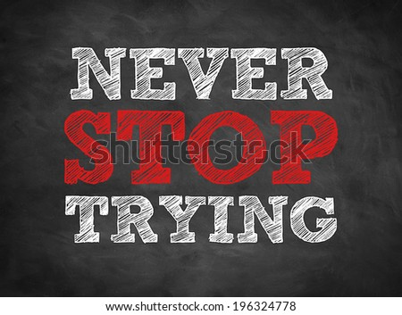 NEVER STOP TRYING written concept on chalkboard - stock photo