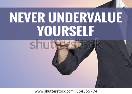 Never Undervalue Yourself word Business man touch on virtual screen soft sweet vintage background - stock photo