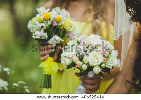neveta girlfriend dressed in beautiful dresses on the wedding walk are in the hands of bouquets