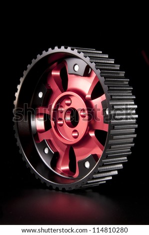 New adjustable pulley for a camshaft on the black - stock photo