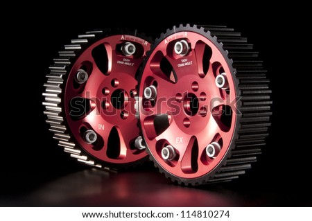 New adjustable pulleys for a camshaft on the black - stock photo