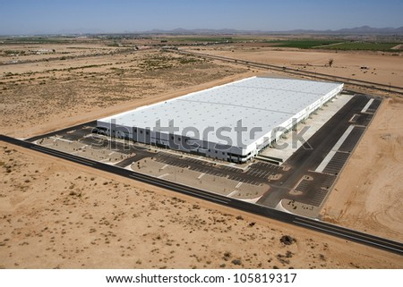 New and modern aerial view of a very large distribution warehouse