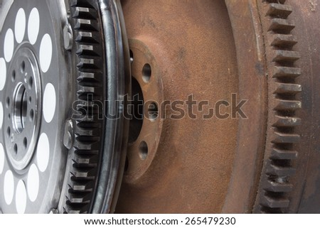 new and old rusty damping flywheels for automotive diesel engines. car parts - stock photo