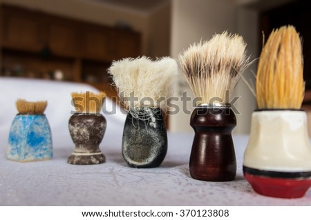 new and old shaving brush in varying degrees of wear - stock photo