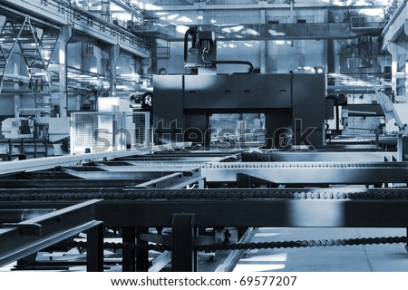 new and powerful metalworking machine in modern workshop - stock photo