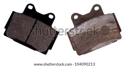 New and worn brake pad, isolated on background