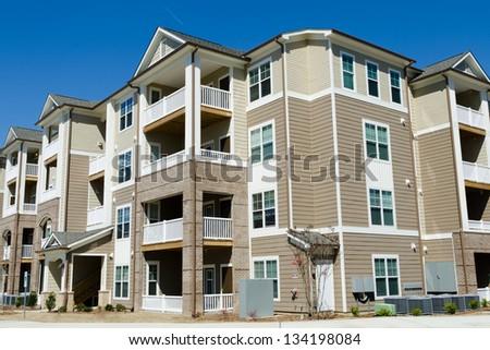 New apartment building in suburban area - stock photo
