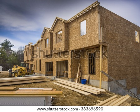 New apartment condo construction in the suburbs - stock photo