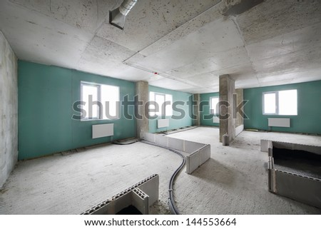 New apartment in building under construction without finishing and with markings of walls. - stock photo