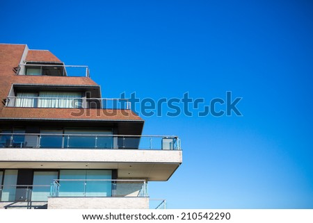 New apartments building and blue sky as a background - stock photo