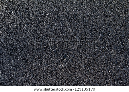new asphalt laid on the road - stock photo