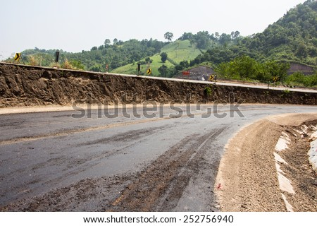 New asphalt. Reconstruction of road - stock photo