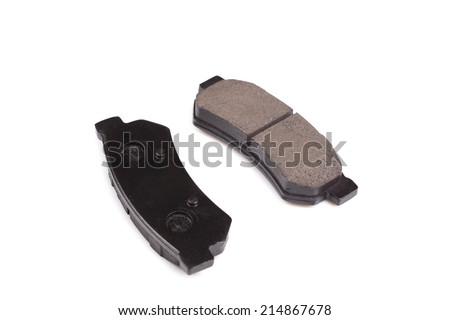 New auto brake pads isolated on white background - stock photo