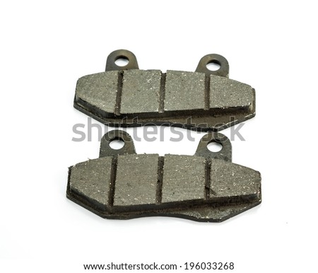 New auto brake pads on white background - stock photo