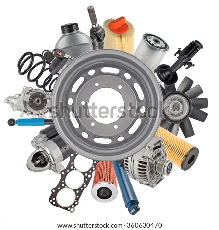 New auto spare parts around wheel rim isolated on white background - stock photo