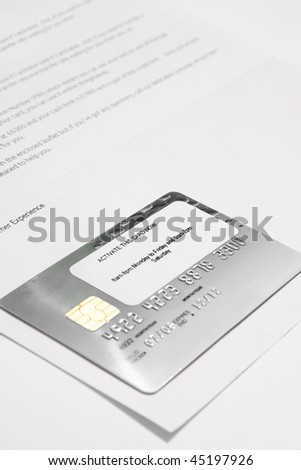 new bank card still attached to bank letter with activate sticker still on card