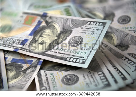 New banknotes of dollars on a white background