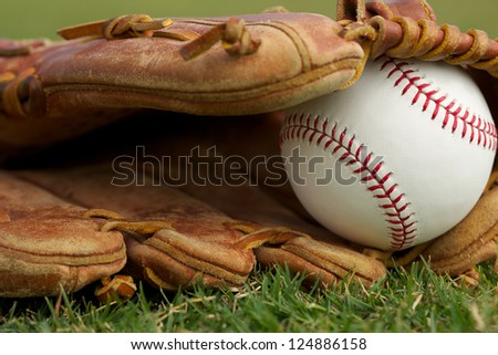 New Baseball in a Glove Close Up