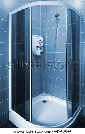 New beautiful shower cubicle in a modern bathroom - stock photo