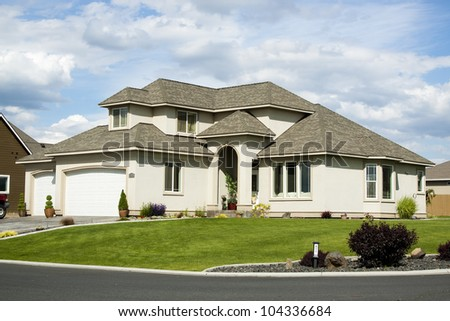 new beautiful suburban luxury house at sunny day - stock photo