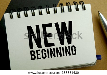 New beginning memo written on a notebook with pen