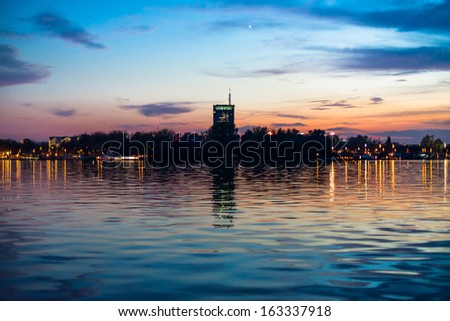 New Belgrade district at sunset from Sava mouth - stock photo