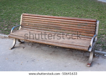New Bench in a park - stock photo