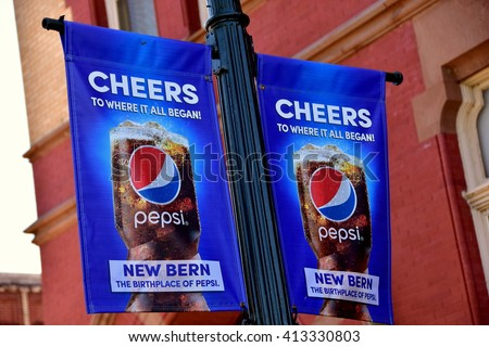 New Bern, North Carolina - April 24, 2016:  Banners hung on lamp post yardarms promote New Bern as the birthplace of Pepsi-Cola