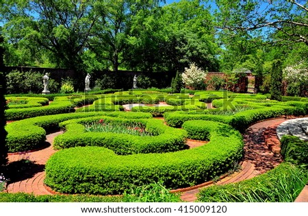 New Bern, North Carolina - April 24, 2016: Clipped Boxwood hedges line brick pathways in the Maude Moore Latham Memorial Knot Garden at 1770 Tryon Palace