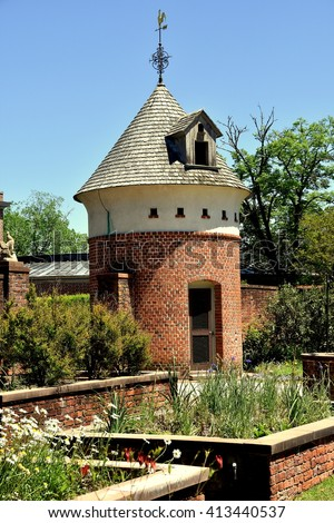 New Bern, North Carolina - April 24, 2016: Raised brick planting beds with dovecote in the gardens at 1770 Tryon Palace