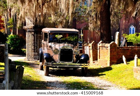 New Bern, North Carolina - April 24, 2016: Vintage 1929 Model A Ford sightseeing vehicle touring historic Cedar Grove Cemetery