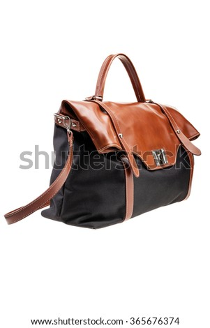 New black and brown womens bag isolated on white background. - stock photo