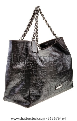 New Black leather womens bag with crocodile texture isolated on white background. - stock photo