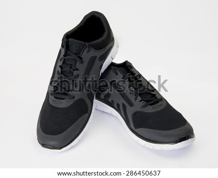 New black sports shoes on white background