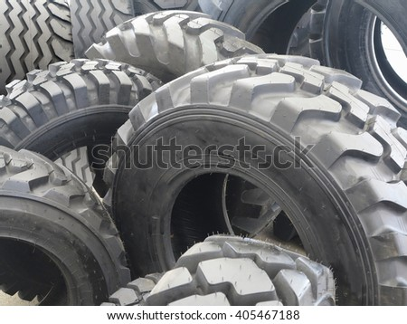 New black tractor abstract tire wheels background. - stock photo