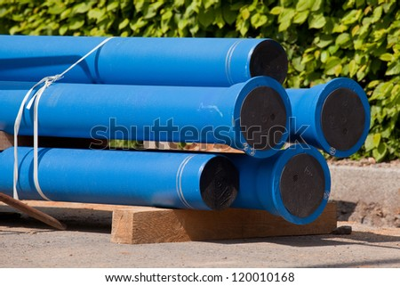 New blue pipes for water supply - stock photo