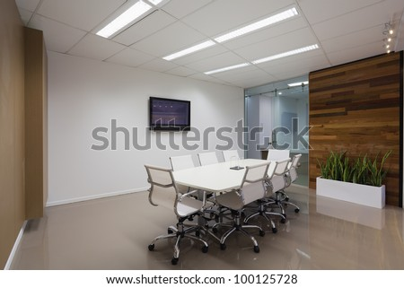 New board room with table, chairs and plasma display. - stock photo
