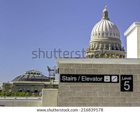 New Boise parking garage with Capital building  - stock photo