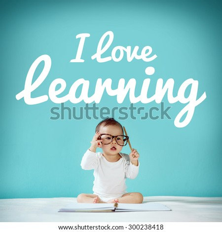 "New born and blackboard with ""I love learning"" on background, School concept - stock photo"