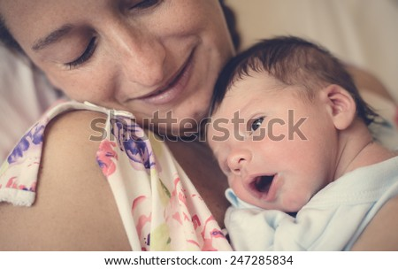 New born and his mother. - stock photo