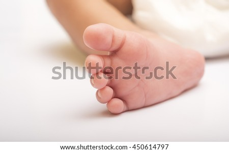 New Born baby adorable feet close up