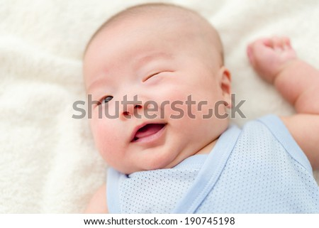New born baby blink eye - stock photo