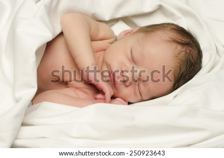New born baby boy sleeping. Little baby taking a nap in white sheets.