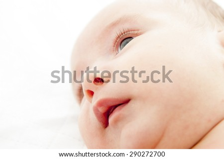 New born baby face on the bed - stock photo