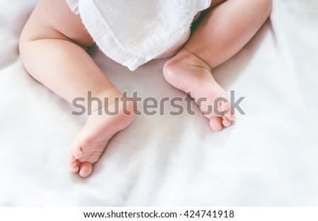 New born baby feet - stock photo