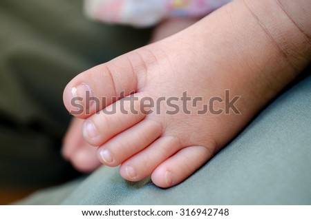 New born baby foot, Close up and selective focus - stock photo
