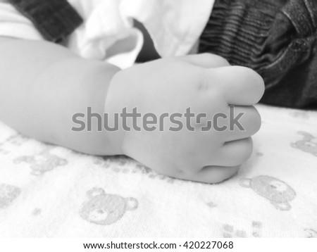 New born baby hand, soft focus - stock photo